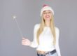 Blonde Girl in Santa Hat Holding Sparkler